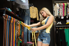 Happy woman shopping in clothing store Royalty Free Stock Image