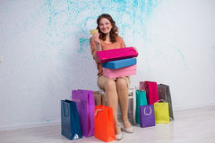 Happy woman after shopping with colourful bags, boxes, banking c Royalty Free Stock Photos