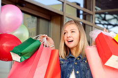 Happy woman shopping and holding bags Stock Image