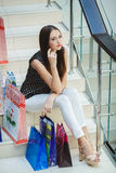 Happy woman shopping and holding bags at the mall Royalty Free Stock Image