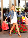 Happy woman shopping and holding bags Royalty Free Stock Photography