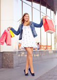 Happy woman shopping and holding bags Royalty Free Stock Images