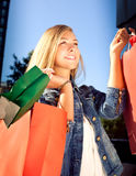 Happy woman shopping and holding bags Royalty Free Stock Image