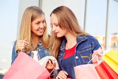 Happy woman shopping and holding bags Royalty Free Stock Photos