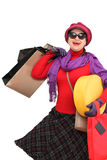 Happy woman shopping. Holding many shopping bags isolated on a white background Stock Photography