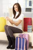 Happy woman after shopping at home Stock Photography