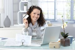 Happy woman shopping on Internet Royalty Free Stock Photography