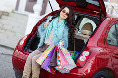 Happy woman after shopping loads your car Royalty Free Stock Photos