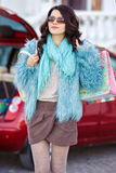 Happy woman after shopping loads your car Royalty Free Stock Image