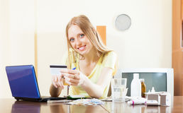 Happy woman shopping medications on internet Stock Photography