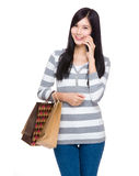 Happy woman shopping with mobile phone Royalty Free Stock Photos