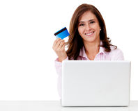 Happy woman shopping online Stock Image