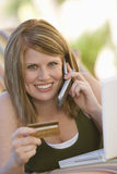 Happy Woman Shopping Online Stock Photos
