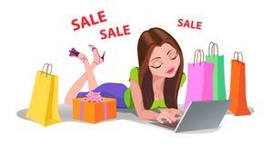 Happy Woman shopping online bads floor Internet Stock Photography