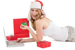 Happy woman shopping online lying on the floor Stock Image