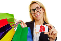 Happy woman shopping for sale and discount offers Royalty Free Stock Photo