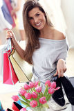 Happy woman shopping for shoes Royalty Free Stock Image