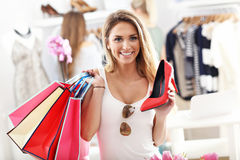 Happy woman shopping for shoes Stock Photos