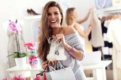 Happy woman shopping for shoes Royalty Free Stock Images