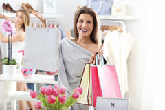 Happy woman shopping for shoes Stock Photography
