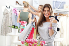 Happy woman shopping for shoes Royalty Free Stock Photos
