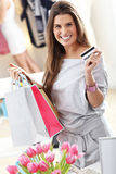 Happy woman shopping for shoes Royalty Free Stock Photo