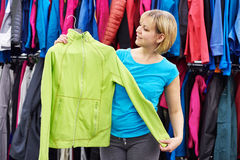 Happy woman shopping for sportswear in shop Stock Photos