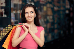 Happy Woman Shopping in a Store Stock Images