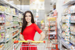 Happy Woman Shopping  at The Supermarket Royalty Free Stock Images