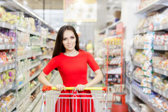 Happy Woman Shopping  at The Supermarket Royalty Free Stock Photo