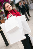 Happy  woman shopping with white bags Stock Photography