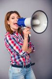 Happy woman shouting in megaphone Stock Photography