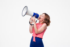 Happy woman shouting in megaphone. Isolated on a white background Stock Photo