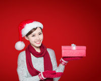 Happy woman show christmas gift Royalty Free Stock Images