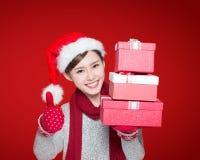 Happy woman show christmas gift Stock Photo