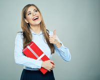 Happy woman show thumb up, hold red gift box. Business woman po stock photo