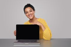 Happy woman showing blank black comuter screen royalty free stock images