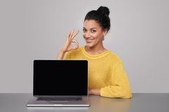 Happy woman showing blank black comuter screen Royalty Free Stock Image