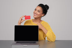 Happy woman showing blank black comuter screen Stock Photos