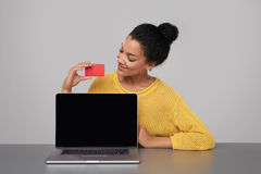 Happy woman showing blank black comuter screen Royalty Free Stock Photography