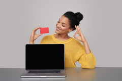 Happy woman showing blank black comuter screen Royalty Free Stock Photos