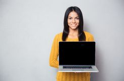 Happy woman showing blank laptop screen Royalty Free Stock Photo