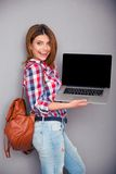 Happy woman showing blank laptop screen Royalty Free Stock Photos