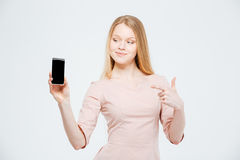 Happy woman showing blank smartphone screen Royalty Free Stock Photo