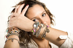 Happy woman showing bracelets Stock Photos