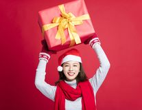 Woman showing the christmas gift Royalty Free Stock Photo