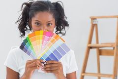 Happy woman showing colour charts Royalty Free Stock Photos