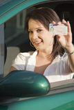 Happy woman showing driving license Stock Image