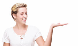 Happy woman showing empty hand for product placement Royalty Free Stock Photography
