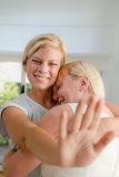 Happy woman showing engagement ring to mother Royalty Free Stock Photography